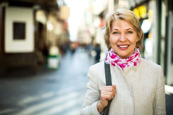 Woman-Happy-Downtown-Financial-Advisors