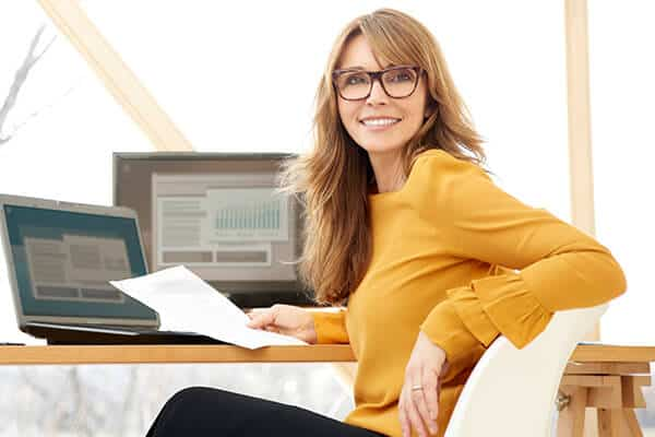 woman-on-computer-researching-what-is-a-self-directed-ira