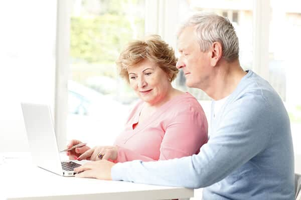 Couple-Researching-Health-Savings-Account-HSA