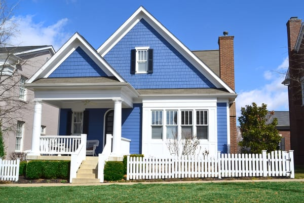 Blue-House-Fence-What-is-a-Real-Estate-IRA
