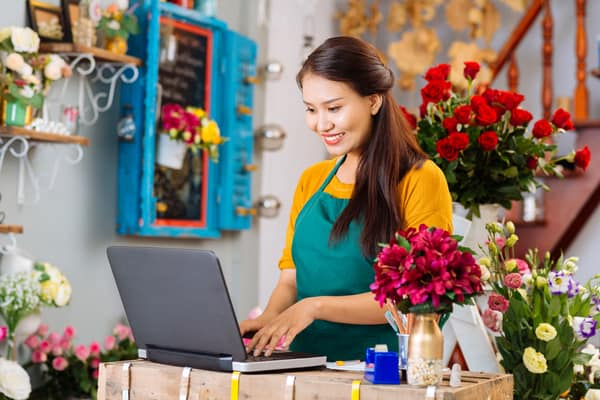 Flower-Shop-Woman-on-Laptop-SIMPLE-IRA
