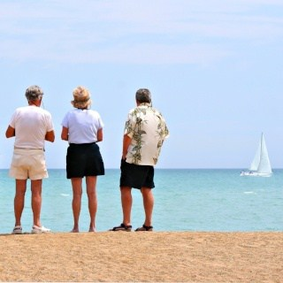 Retirees enjoying a day at the beach because they have financial freedom